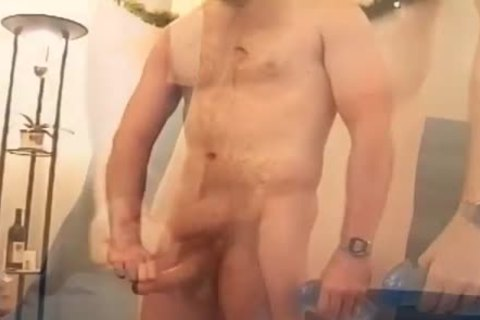nude man In A Baseball Cap Strokes His unyielding dick